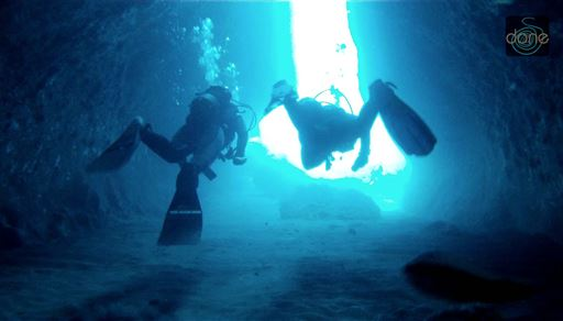 Scuba diving in Caves area, Santorini in Greece